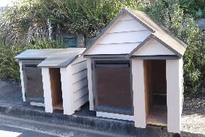 Weatherboard dog kennels from dogkennelevolution.co.nz